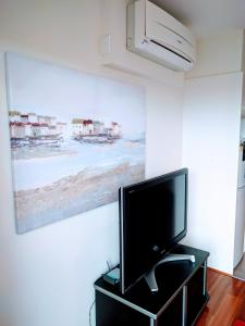 A television and/or entertainment center at Glen Waverley Apartment