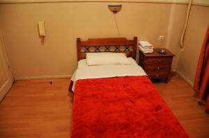 Ένα ή περισσότερα κρεβάτια σε δωμάτιο στο Αργώ