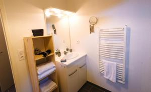A bathroom at Appart'Hôtel - Belle Vue - Studio with Kitchen