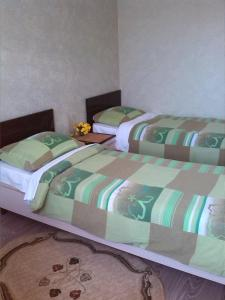 A bed or beds in a room at Guest House on Festivalnaya