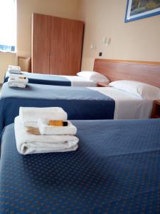 Letto o letti in una camera di Hotel Residence Degra