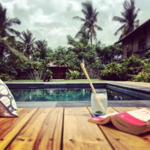 The swimming pool at or near Manusia Dunia Green Lodge