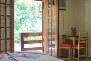 A bunk bed or bunk beds in a room at Pousada Riacho da Serra