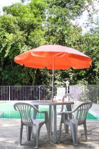 The swimming pool at or close to Pousada Riacho da Serra