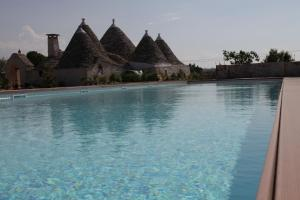 The swimming pool at or close to Trulli Paparale