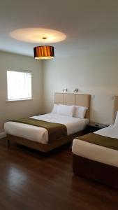 A bed or beds in a room at St Bridget's Serviced Apartments