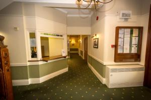 The lobby or reception area at The Golf Hotel