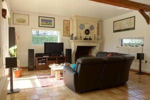 Area soggiorno di Chambre D'Hôtes le Phenix