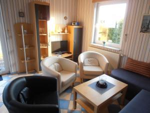 Ein Sitzbereich in der Unterkunft Ferienhaus Undine