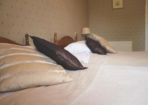 A bed or beds in a room at Old Rectory