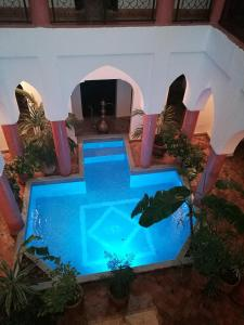 A view of the pool at Riad Al Tainam or nearby