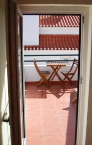 A balcony or terrace at Hakuna Matata Hostel