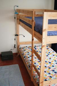 A bunk bed or bunk beds in a room at Hakuna Matata Hostel