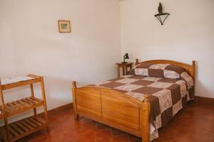 A bed or beds in a room at La Casa de Cafe Bed and Breakfast