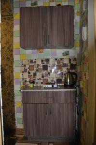 A kitchen or kitchenette at Apartments at Serafimovicha 30