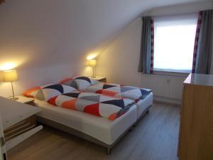 Ein Bett oder Betten in einem Zimmer der Unterkunft Apartment Seven Ducks