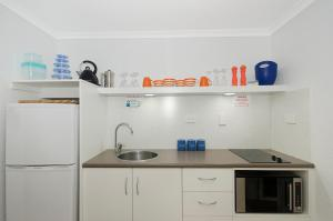 A kitchen or kitchenette at By The Sea Port Douglas