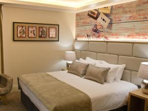 A bed or beds in a room at The Residence Hotel