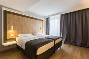 A bed or beds in a room at M Hotel
