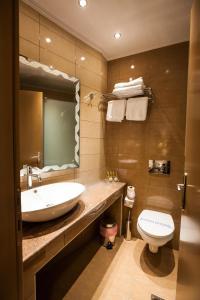 Ein Badezimmer in der Unterkunft Hotel Marianna
