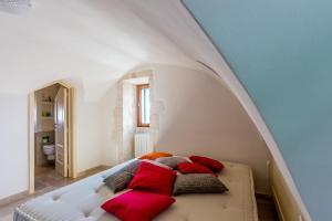 Letto o letti in una camera di Casa Garibaldi