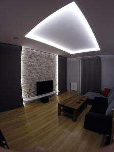 A television and/or entertainment center at A3XD Apartament 2