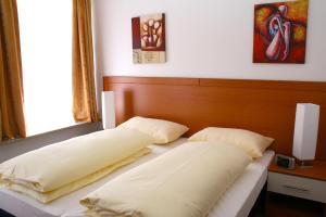 Ein Bett oder Betten in einem Zimmer der Unterkunft Hotel Evido Salzburg City Center