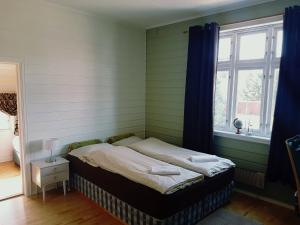 A bed or beds in a room at Villa Nyborg