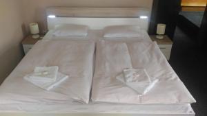 Кровать или кровати в номере Hotel Marion