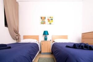 A bed or beds in a room at Seaside Apartments Malta Mellieha1