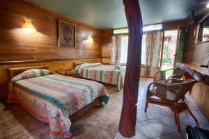 Cama o camas de una habitación en Hotel Manavai