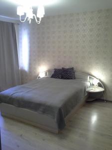 Кровать или кровати в номере Апартаменты на Советской Набережной