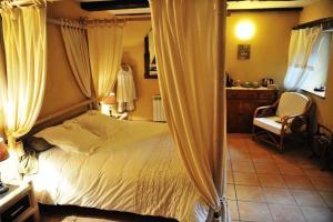 Un ou plusieurs lits dans un hébergement de l'établissement Chambres d'Hôtes Le Puits d'Amour