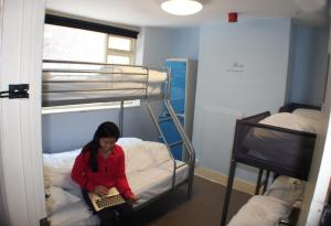 A bunk bed or bunk beds in a room at Dover Adventure Backpackers