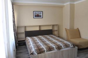 Кровать или кровати в номере Мини отель Тихая гавань