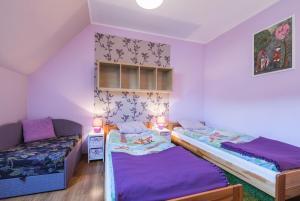 Łóżko lub łóżka w pokoju w obiekcie Apartamenty u Kukuca