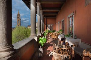Een restaurant of ander eetgelegenheid bij Hotel Palazzo Guadagni