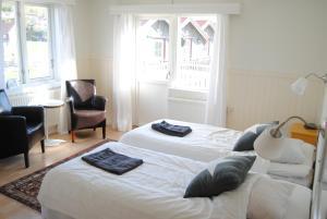 Säng eller sängar i ett rum på Nösund Havshotell