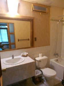 Un baño de Hotel Manavai