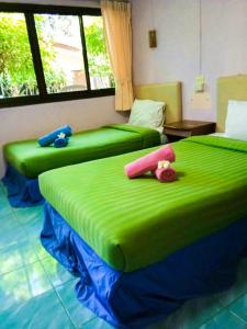 A bed or beds in a room at Aonang Blue Ba You Bungalow