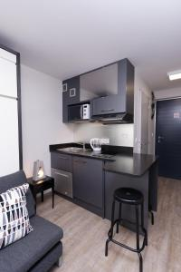 A kitchen or kitchenette at At home in lyon