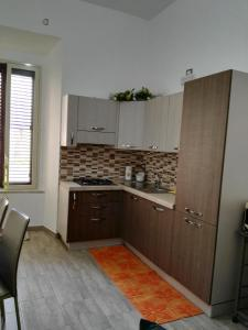 A kitchen or kitchenette at Casa Archimede