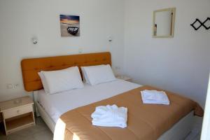 Ένα ή περισσότερα κρεβάτια σε δωμάτιο στο Kappatos Studios & Apartments