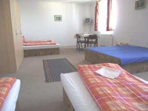 A bed or beds in a room at Penzión Slávia