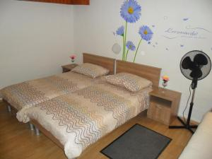 A bed or beds in a room at Vile Park Studio Apartments