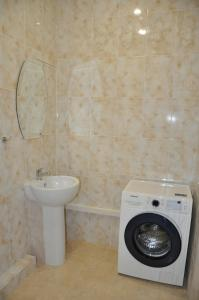 Ванная комната в Apartment On Turisticheskaya 4A
