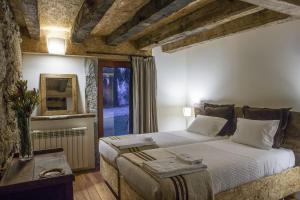 Uma cama ou camas num quarto em Quinta do Rapozinho