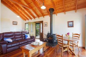 A seating area at Romantic Cottage for 2