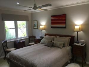 A bed or beds in a room at Karri House. Eat - Stay - Love