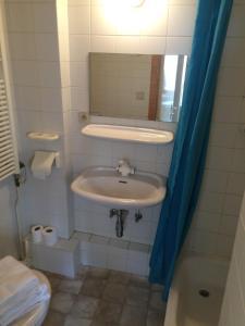 Een badkamer bij Logies De Wandelaar